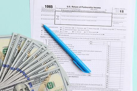 1065 tax form lies near hundred dollar b