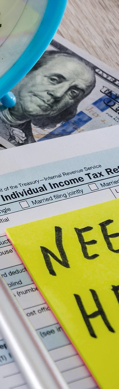 tax form 1040, dollars and an alarm cloc