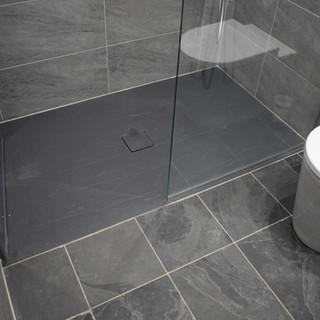 Flush slate effect shower tray
