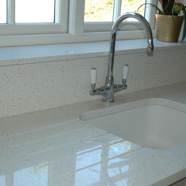 Quartz stone worktop, splashback and window sill