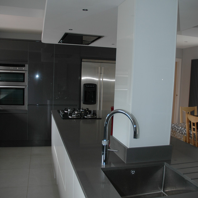 Gloss handless kitchen with contrast grey and white units
