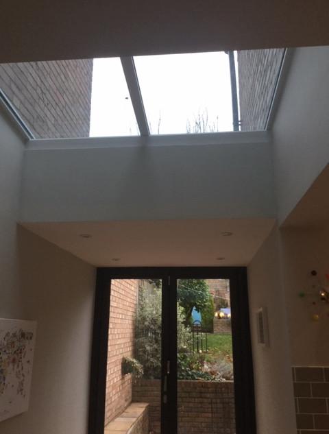 Fixed rooflight and bi fold door
