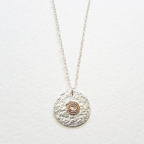 Silver circle with 9k gold Caracola pendant