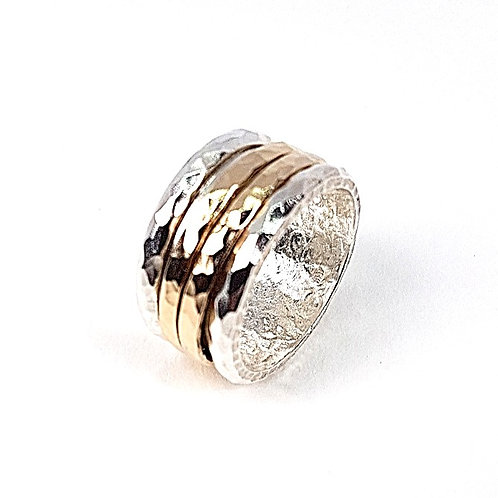 Silver and gold revolving ring