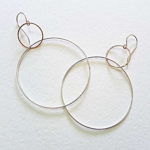 Modern two hoops large earrings in silver and gold