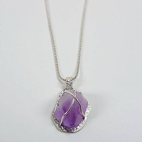 Raw Amethyst in silver pendant
