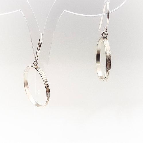 Delicate silver medium hoops earrings