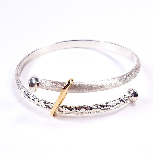 Large silverwith gold bracelet over lapping ends