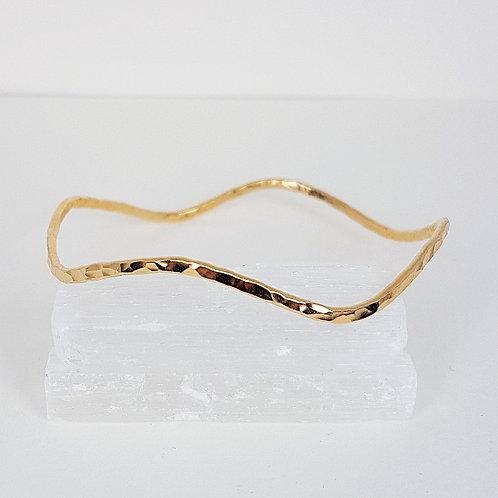 Gold hammered Wave bangle