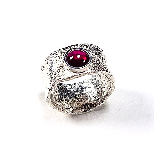 Reticulated unformed silver ring with Red Corundum stone