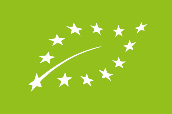 A white leaf formed from the 12 stars of the European Union, on a green background.