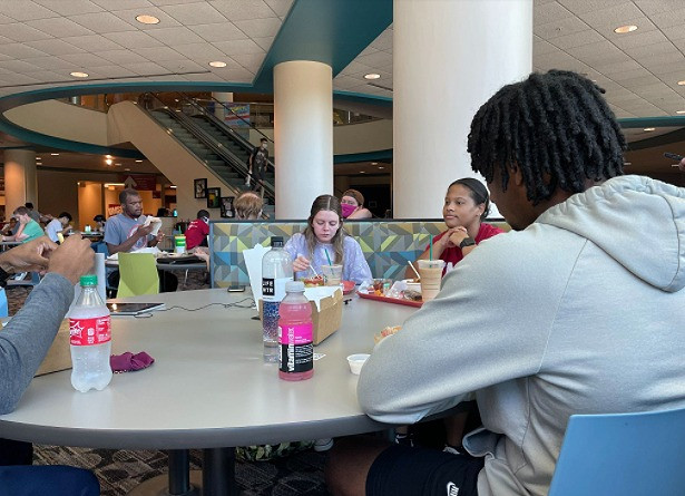 Student gives her feedback about food options and times at lunch