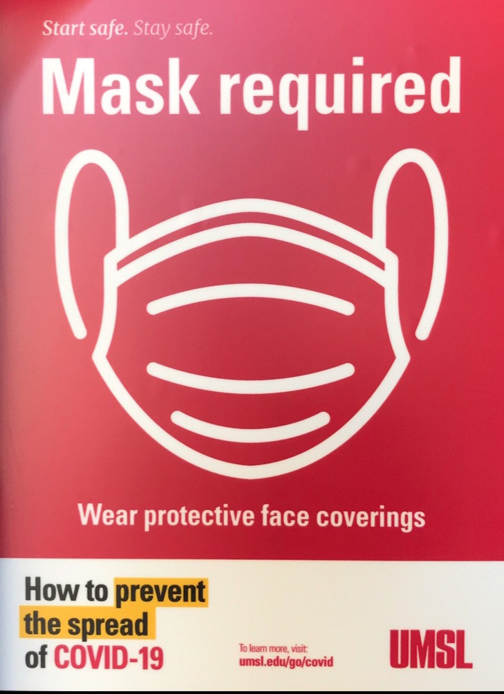 A mask required sign on UMSL's campus