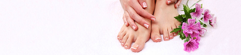 Image of manicured hands and pedicured feet