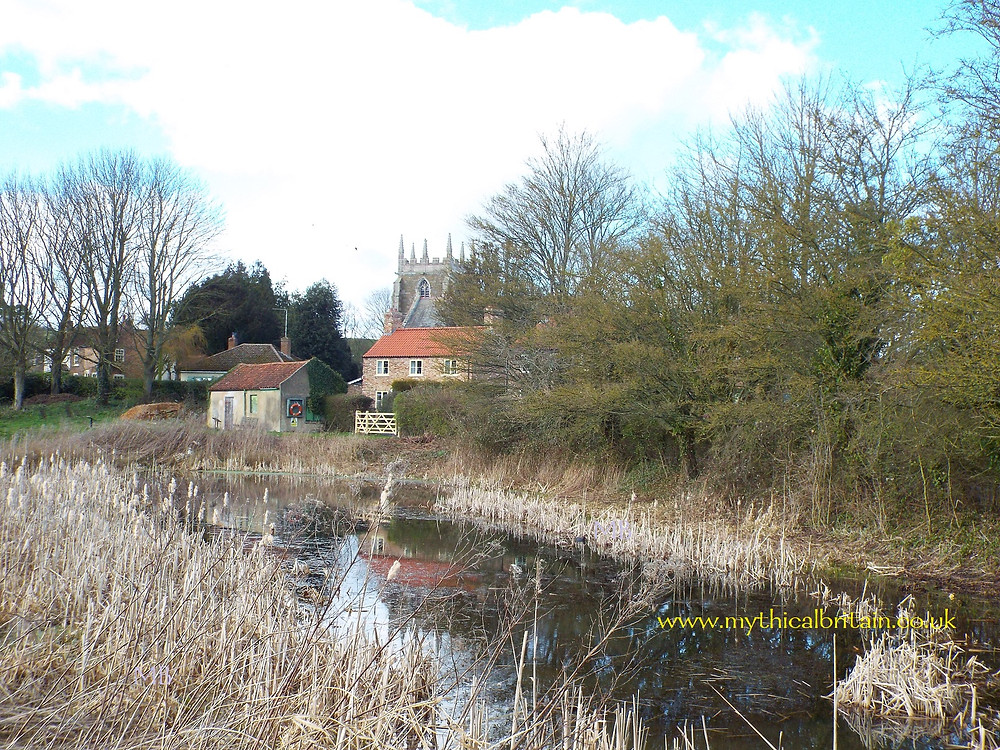 The view of Bolingbroke church from over the moat of the castle