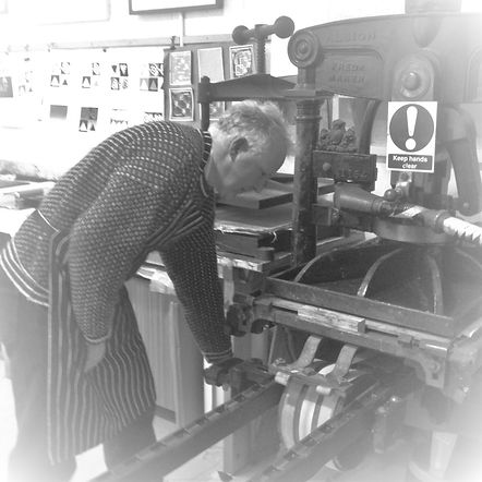Michael Smith using the Albion printing press