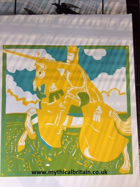 Image of a linocut print of King Arthur showing two colours from the final four.