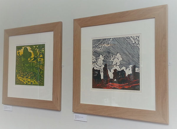 Image showing two framed prints of mediaeval subjects by Michael Smith of Mythical Britain