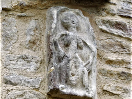 The Sheela Na Gig sculpture and St Christopher wall paintings at Oaksey in Wiltshire, England