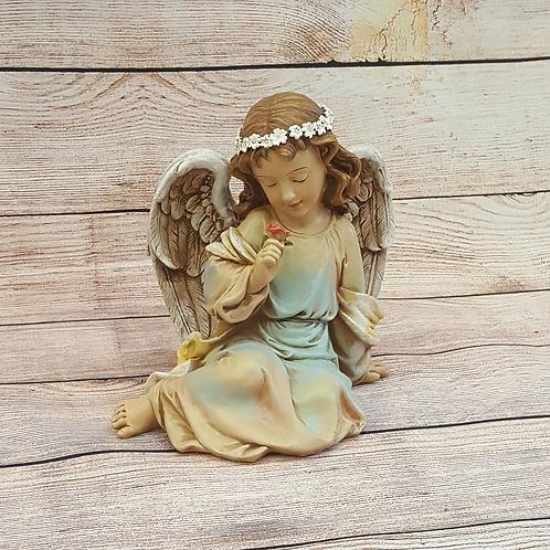 ANGEL SITTING SMELLING FLOWER