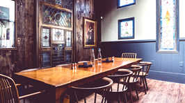 The private back room with a long table and 10 chairs available for reservations at Brennan's