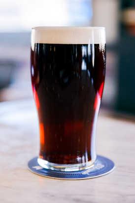 A pint of a dark beer
