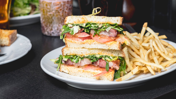 A plate of fries and a sandwich