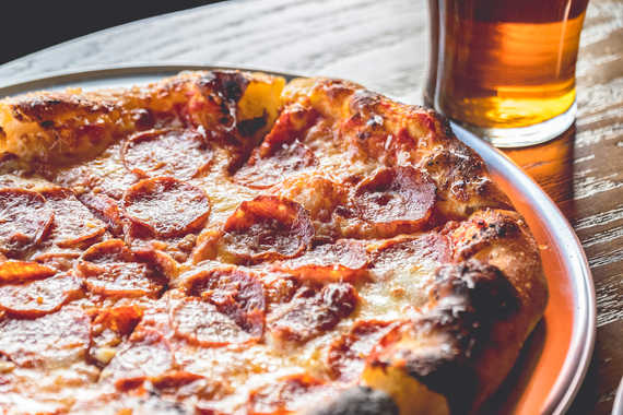 Pepperoni pizza and a pint of light beer