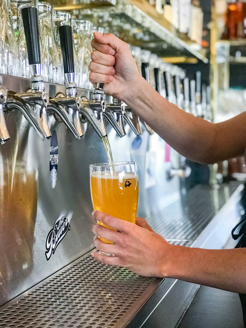 Pouring a light draft beer