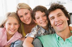 family-in-living-room-smiling_HKmBhjCrj