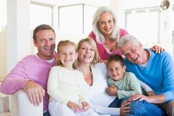 family-sitting-indoors-smiling_BK2cJkRBi