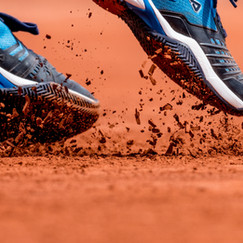 Clay under player's shoes while serving