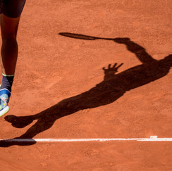 Shadow of Rafael Nadal from Spain while serving