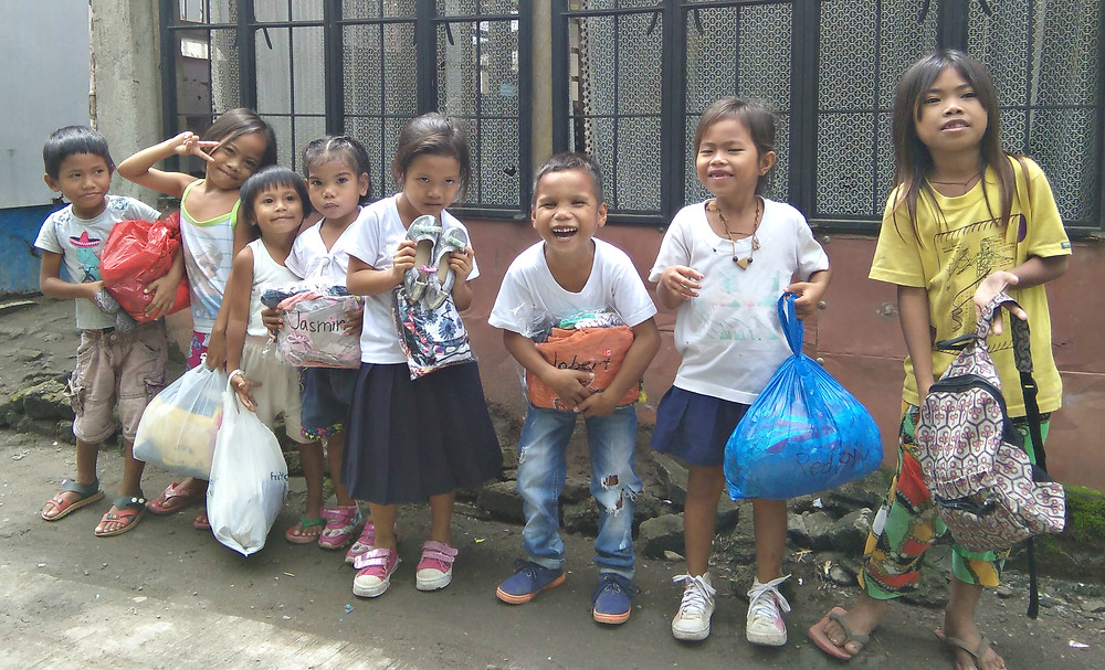 Kids smiling ear to ear with their new clothes and shoes :)