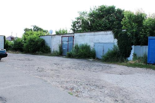 Гараж (участок для магазина) в г. Новый Оскол пл. Революции