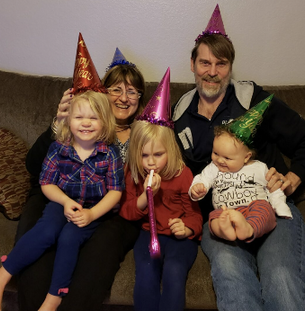 terri and dirk with granddaughters.png