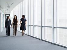Businesswomen Walking in Hallway