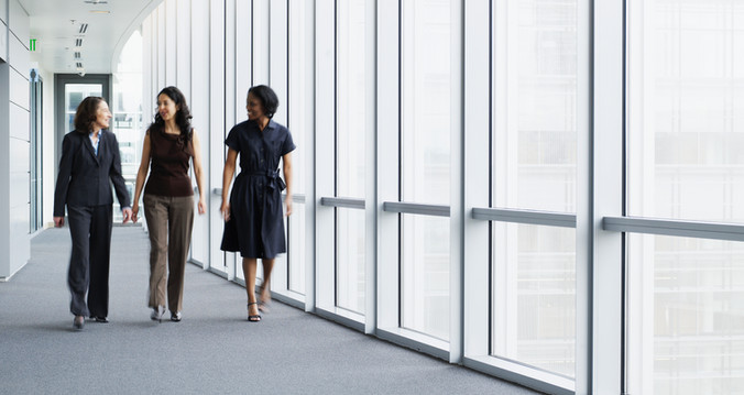 businesswomen-walking-in-hallway