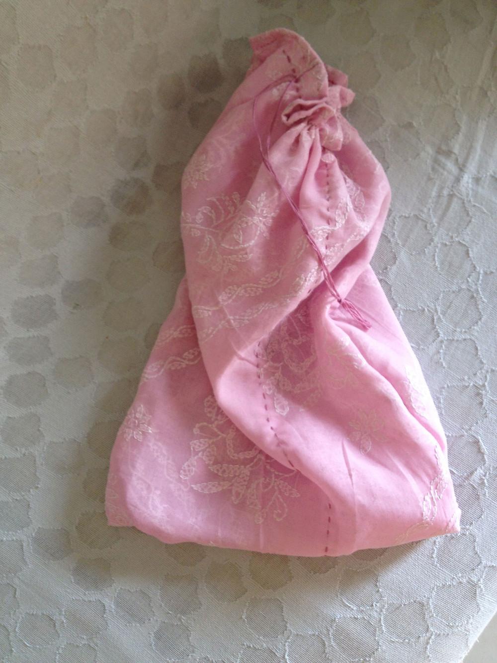 Handstitched drawstring bag off decorative front end (pallu)