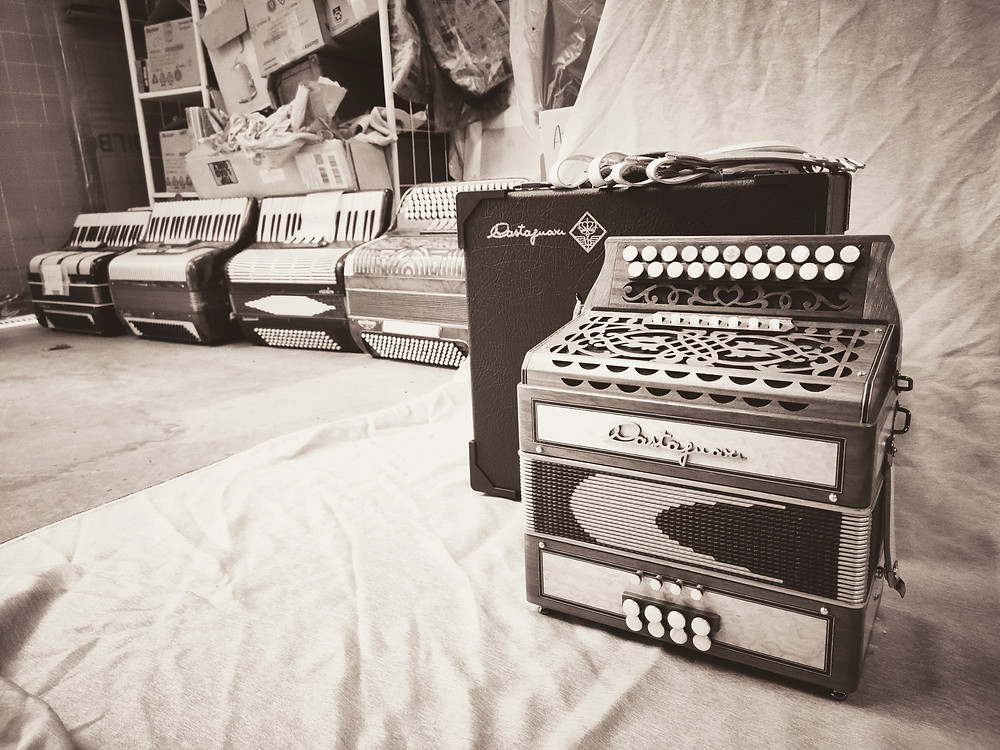 A Castagnari Trilly accordion, having just arrived from Italy, with some older Italian accordions waiting to be fixed up