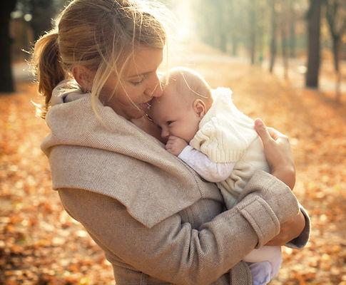 loving mother nurturing her newborn child, children's health, pediatrics