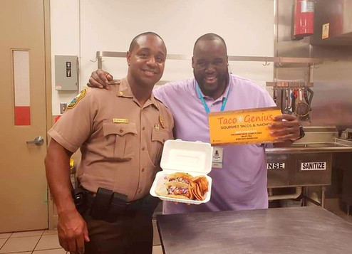 Co-Owner Quinton with Major Charles Jr. of South Dade District