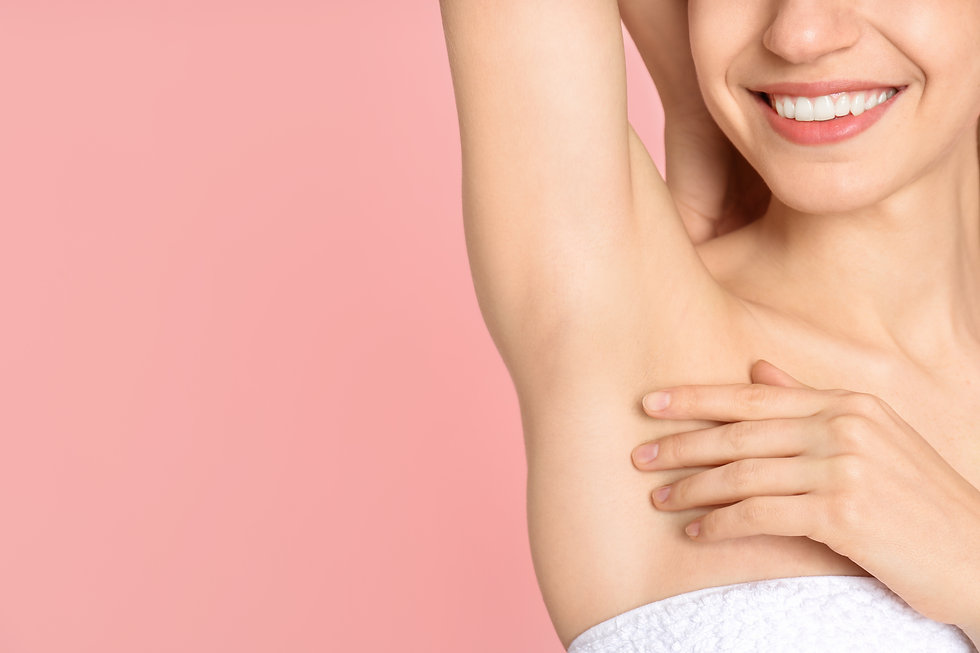 Young woman showing armpit with smooth c