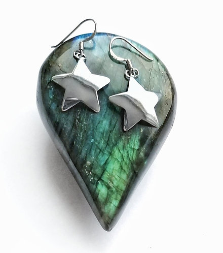 Silver curved star earrings