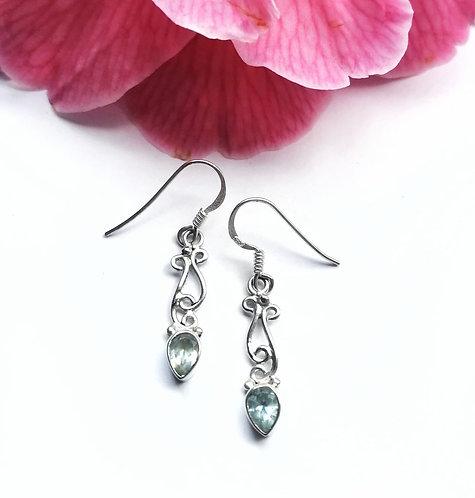 Silver & blue topaz swirling earrings