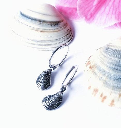 Silver shell dangle hoops