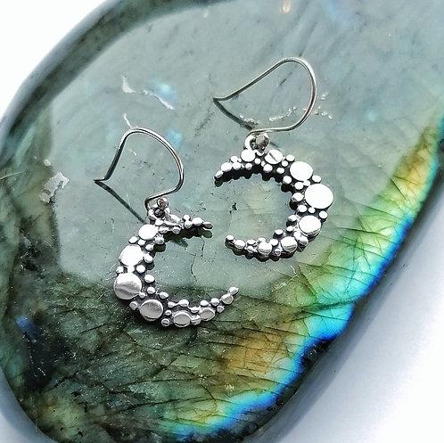 Silver detailed moon earrings
