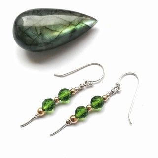 https://www.velvetcrystal.co.uk/product-page/silver-gold-vermeil-with-green-crystal-cascade-earrings