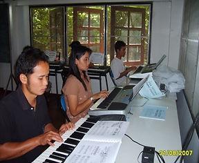 Students playing piano.jpg