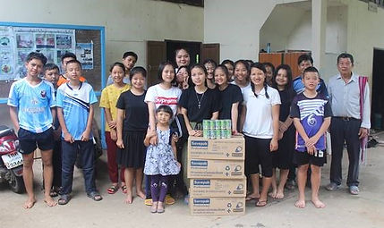 Ajan Buka and students on relief trip 3.